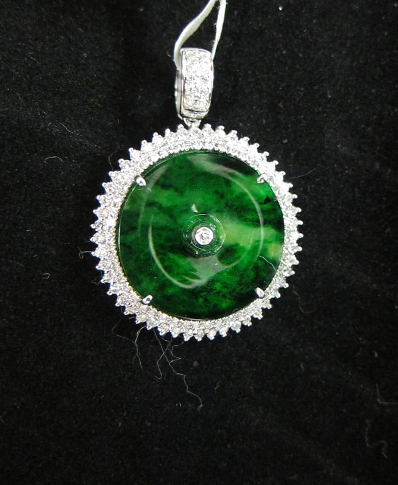 Jade donut pendant surrounded by a halo of round diamonds all set in photo of excellent gems diamonds honolulu hi united states jade donut mozeypictures Gallery