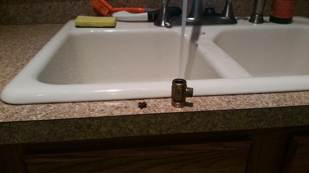 Calcium deposit stuck inside the valve under kitchen sink. - Yelp