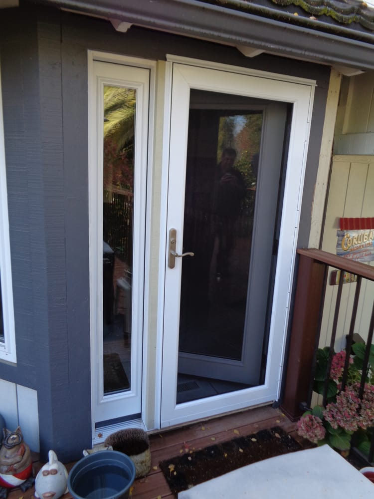 New Rear Entry Door Off The Kitchen With Sidelight And Glass Storm