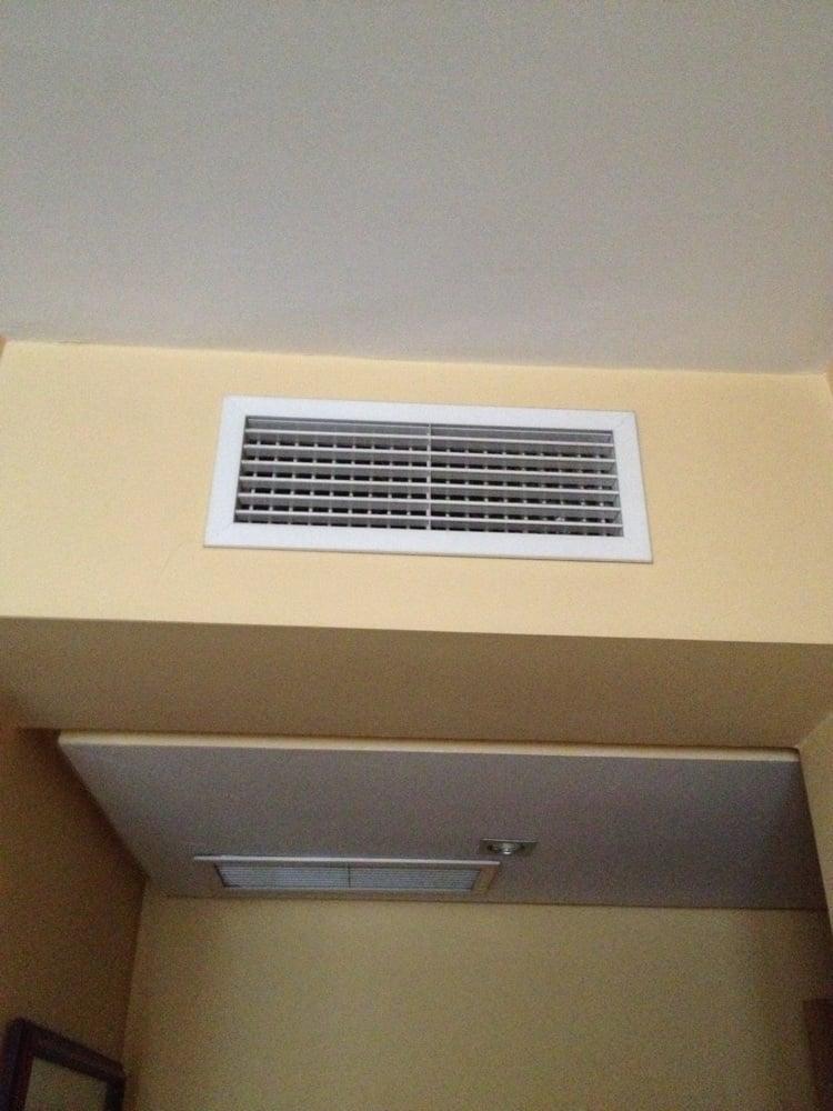 Arte y clima calefacci n y aire acondicionado calle for Salida aire acondicionado