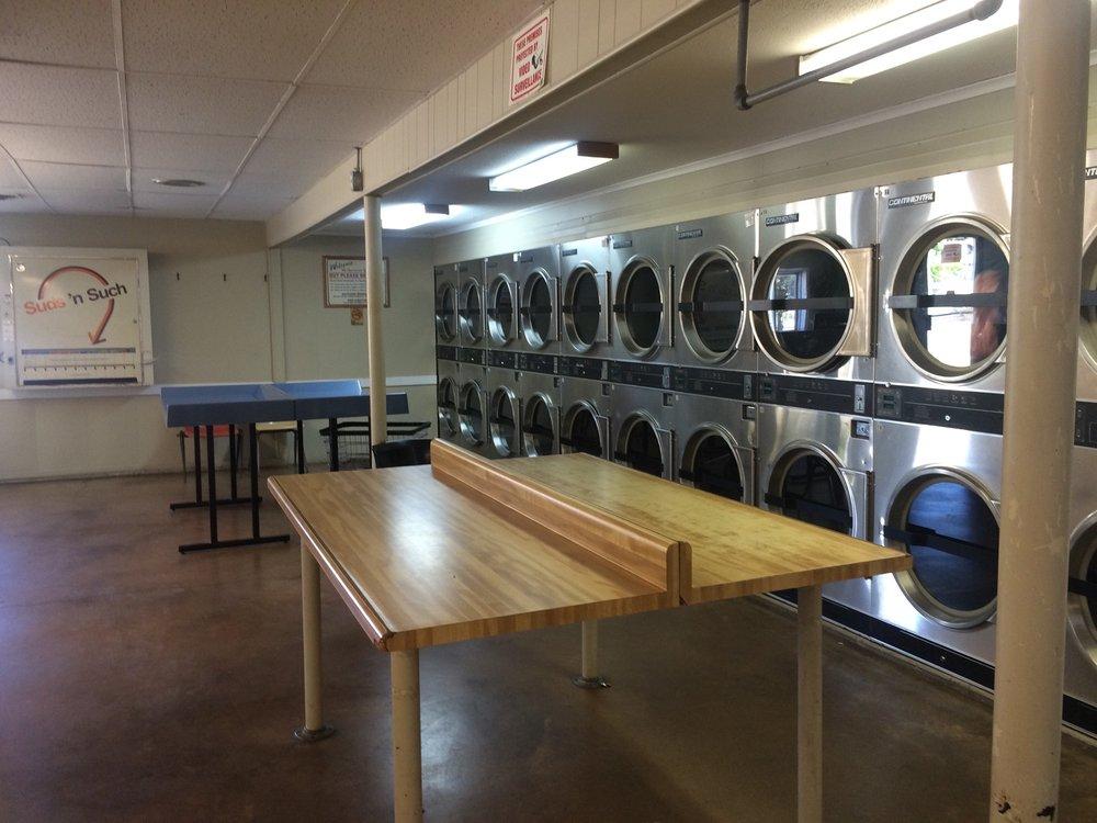 Log Cabin Laundromat: 329 W Monroe St, Dundee, MI