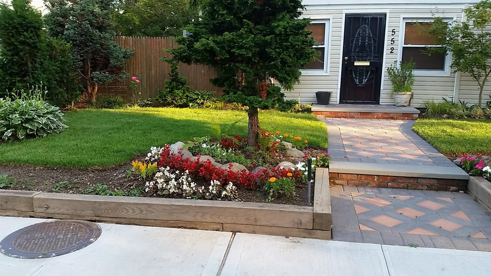 Front Entrance Completed Sidewalk Retaining Wall With