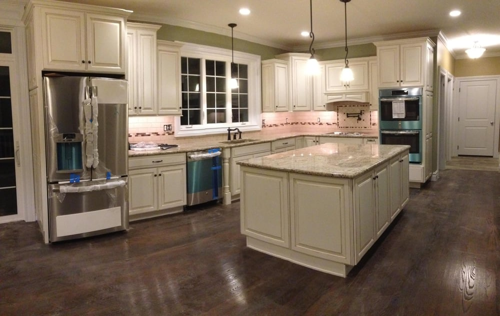 Diamond cabinets sterling maple cabinets with coconut for Almond colored kitchen cabinets