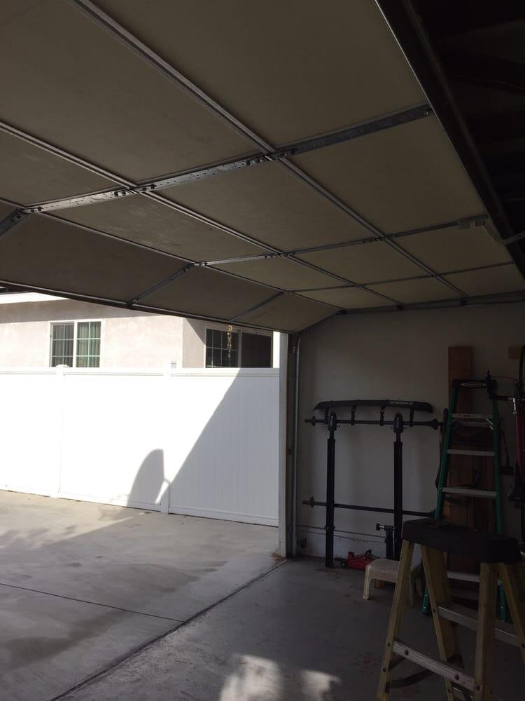 Garage door spring replacement completed yelp for Long beach garage door repair