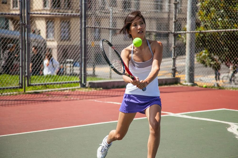 Photo of Tennis Lessons By Mcclain - San Francisco, CA, United States. Notice how Park Couture- custom shirts for men and women, watches the ball to the point of contact