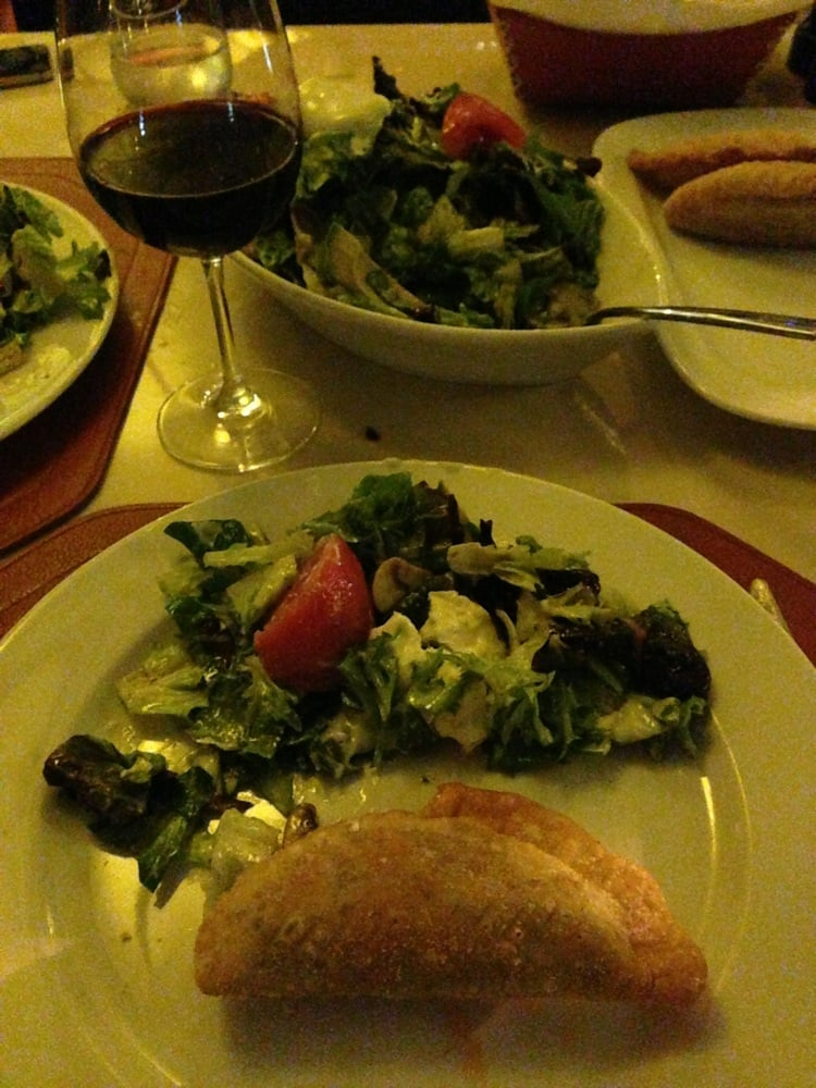 Delicious empanadas and salad to open up the apetite yelp for Pm fish steak house