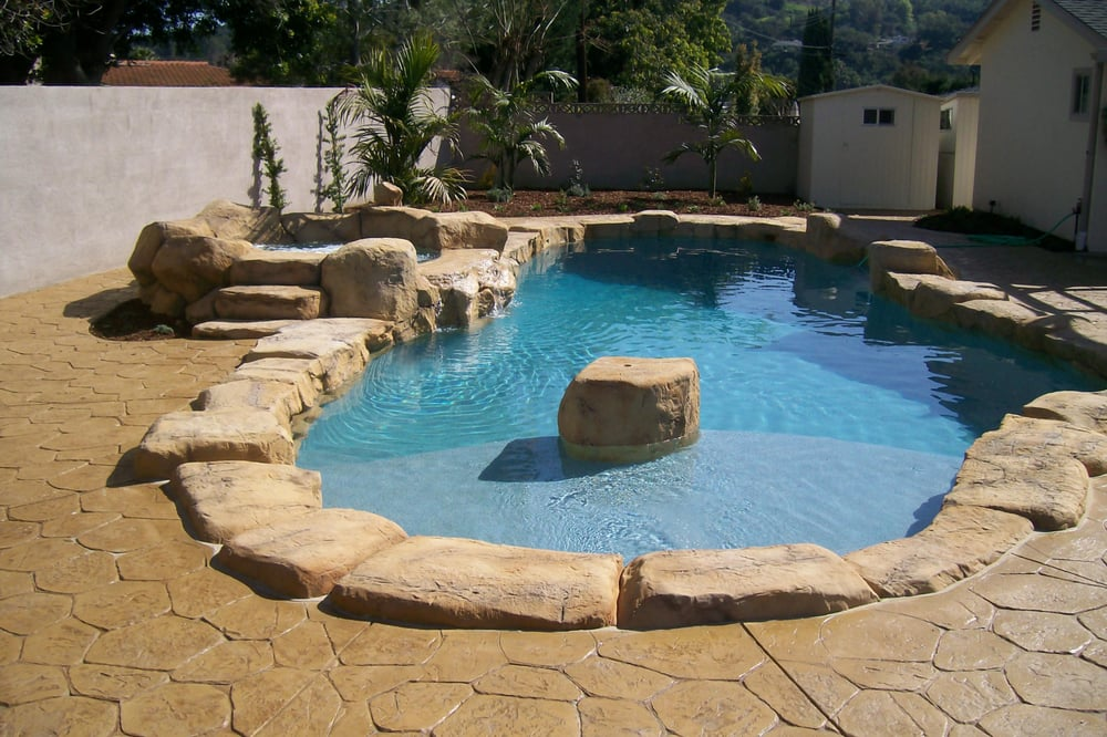 Remodeled swimming pool with new spa custom faux rock for Pool design ventura