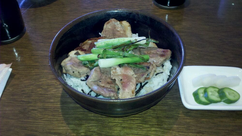 Sliced buck breast w scallions over rice yelp for Asian cuisine allendale nj
