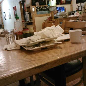 Photo of Himitsu Teriyaki - Kent, WA, United States. Uncleared tables.