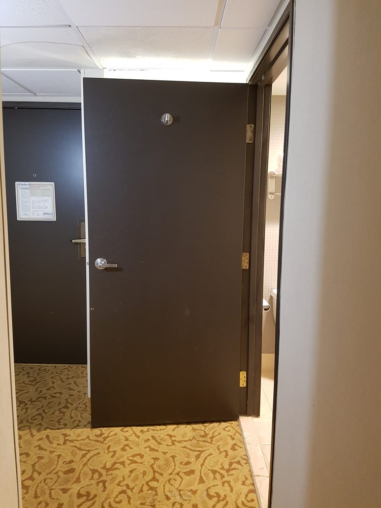 Bathroom Door Opens Into Person Standing At The Sink