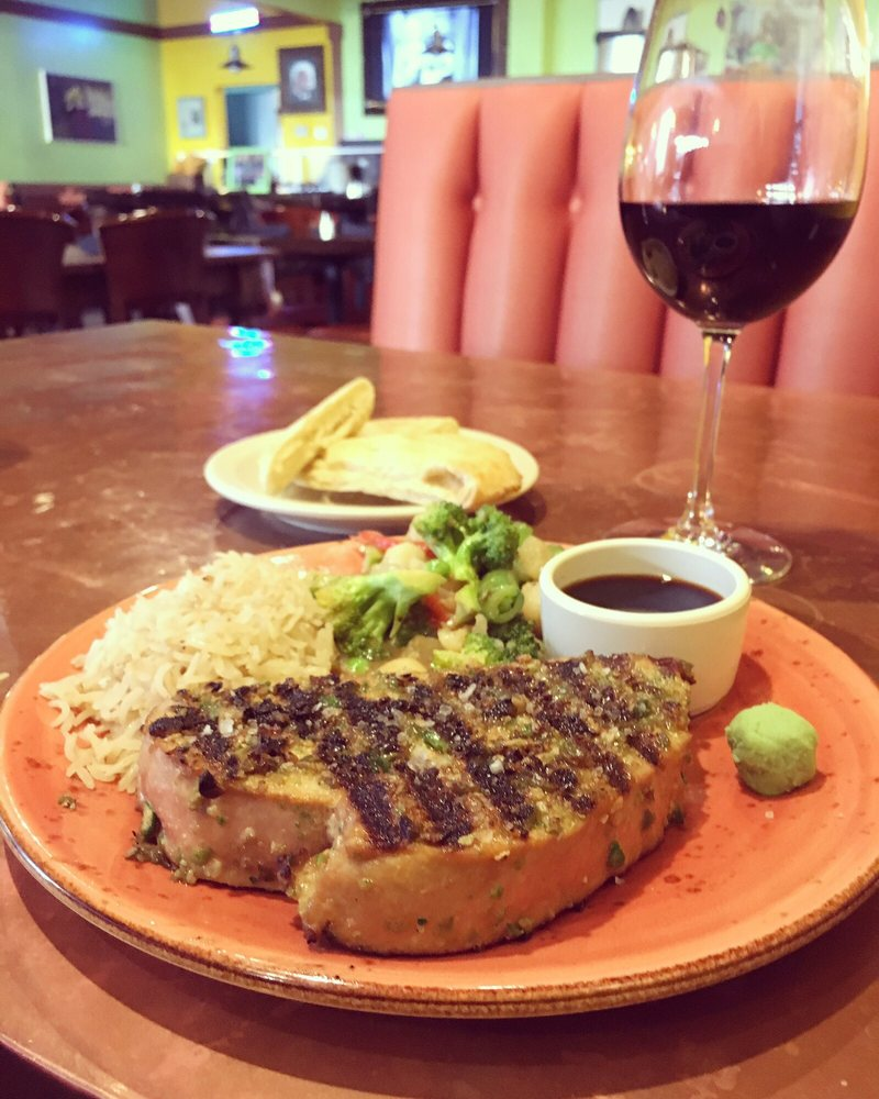 Delicious Tuna Steak With A Glass Of Red Wine And A Plate