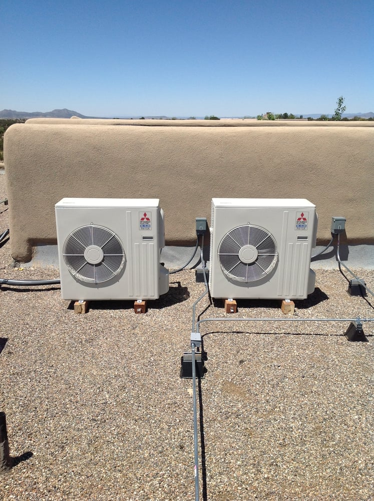 New installation of two outdoor Mitsubishi ductless units on