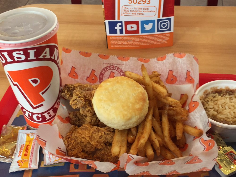 Popeyes Louisiana Kitchen my 6 piece cajun wing dinner with fries, red beans and rice