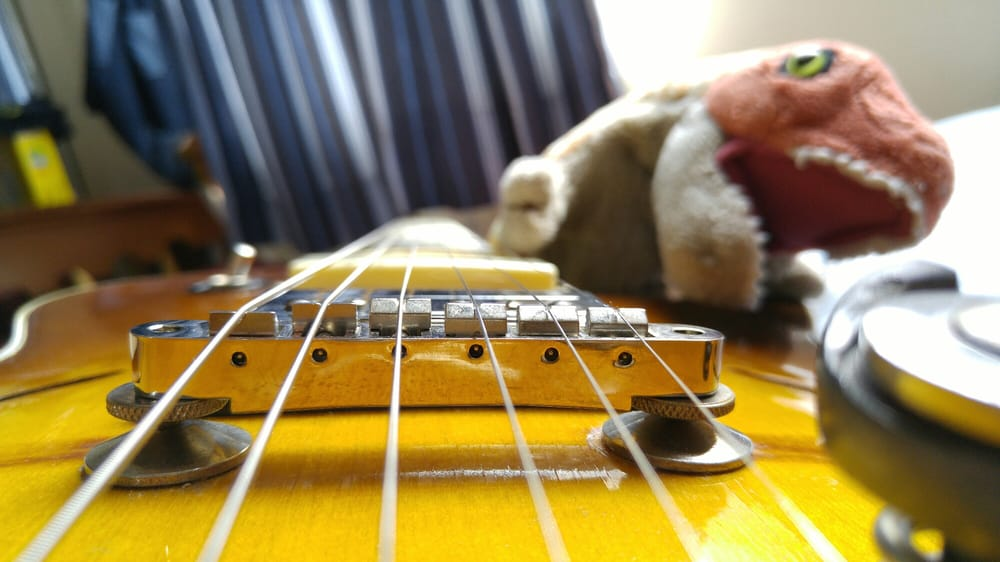 Bridge Saddles Properly Slotted Strings Now Follow Fretboard Radius