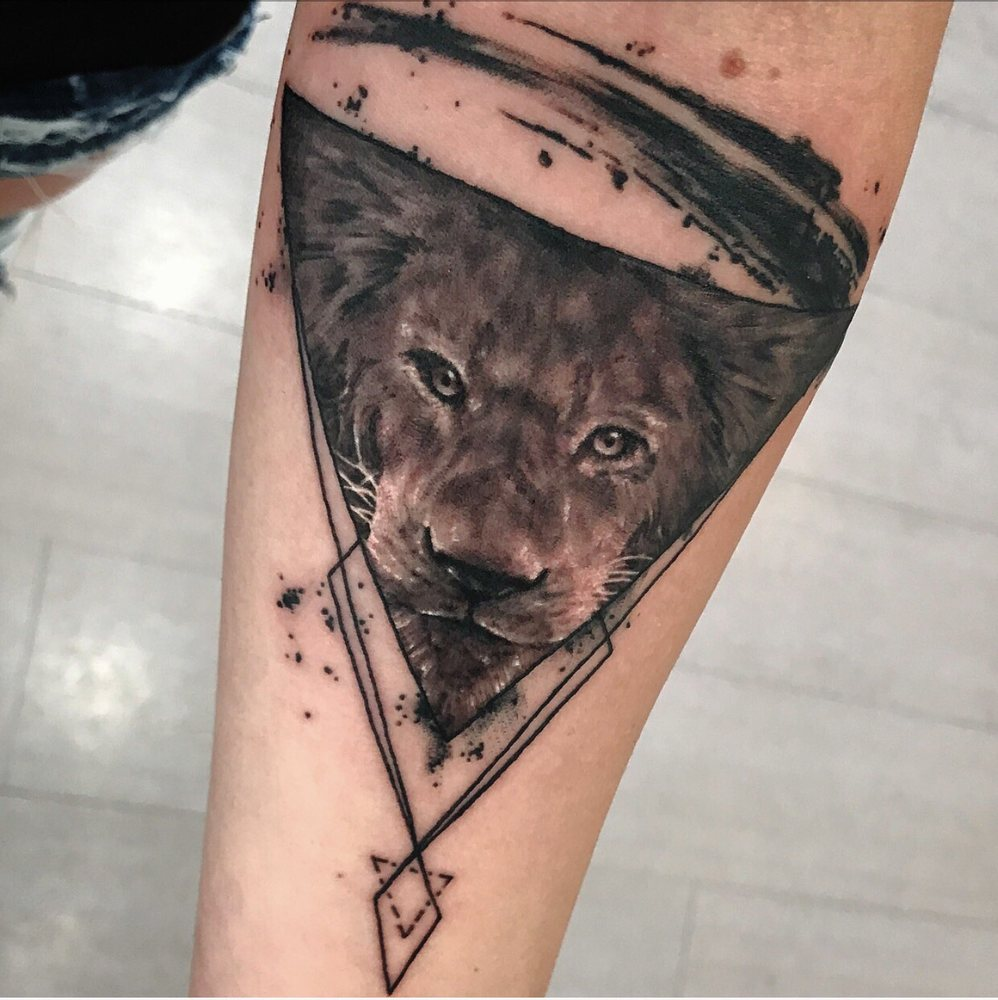 Forearm lion tattoo done by Carlos. - Yelp