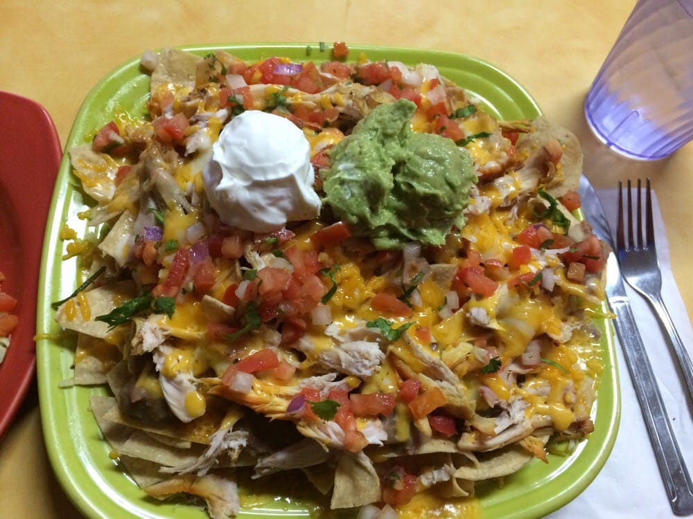 Photo of El Pollo Feliz - Carmichael, CA, United States. Happy pollo nachos (8.95) Now these nachos aren't just topped with the fun stuff, it is LAYERED!  :O