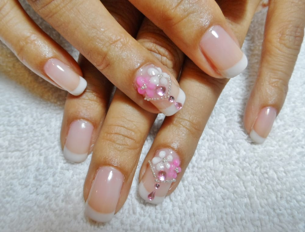 White & pink 3D flowers, pearl gems & stones on French tips gel ...