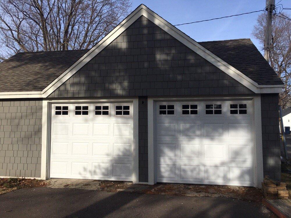Aspen garage doors servizi per porte di garage 1409 for 2 piedi quadrati per garage