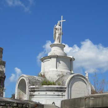 Photo of St. Louis Cemetery No. 1 - New Orleans, LA, United States. Beautiful architecture with the odd bits of nature reclaiming the land.
