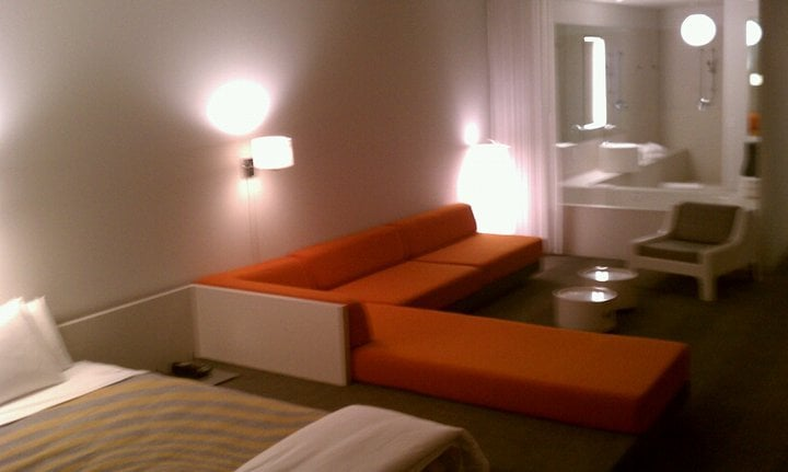 Wow Suite Main Areas: Platform Bed, Living Room with Sectional ...