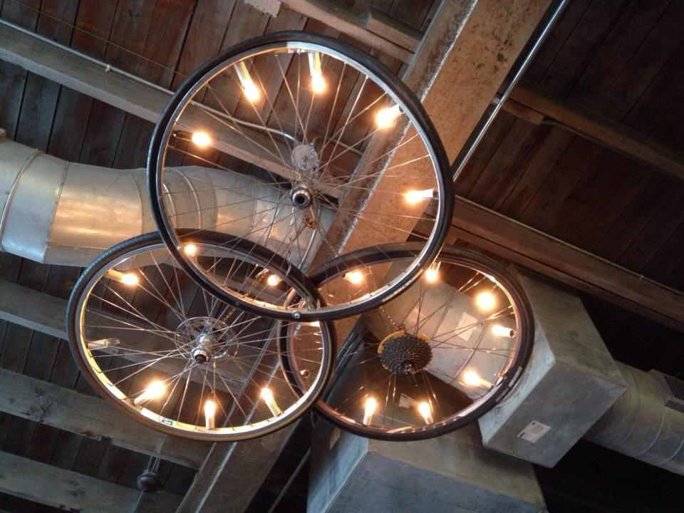 Bicycle wheel chandelier above our table one made of for Bicycle wheel table