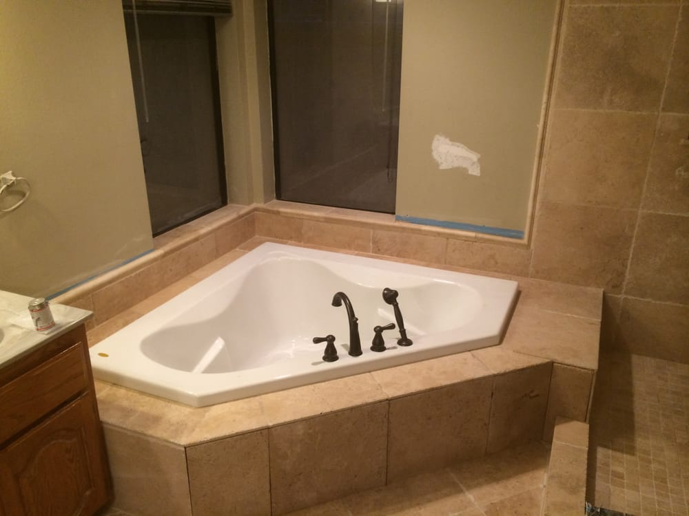 Master bath, drop-in soaking tub with new roman tub faucet with hand ...