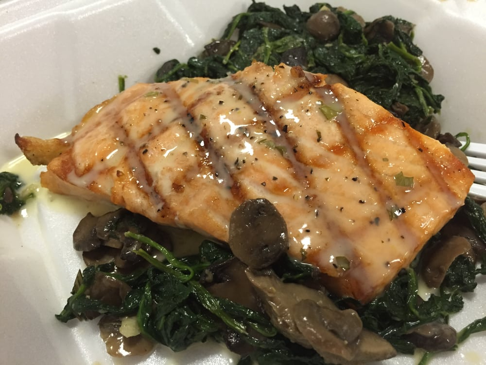 Grilled Salmon With Spinach And Sauteed Mushrooms At