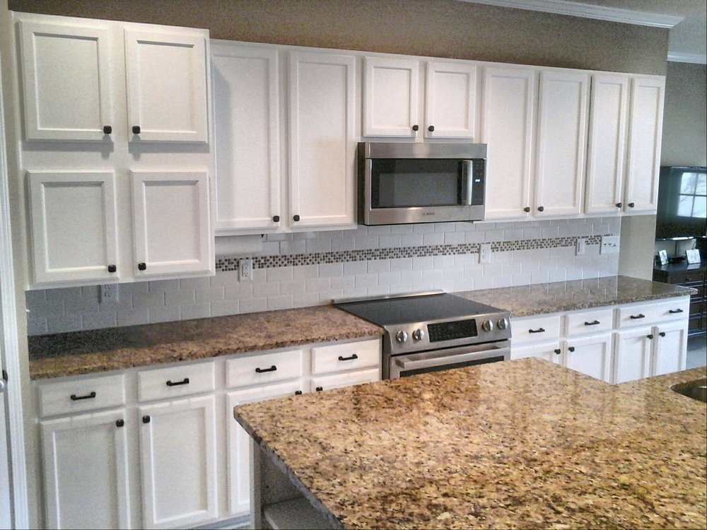 Photo Of Wallscapers Raleigh Nc United States Oak Cabinets Painted White With