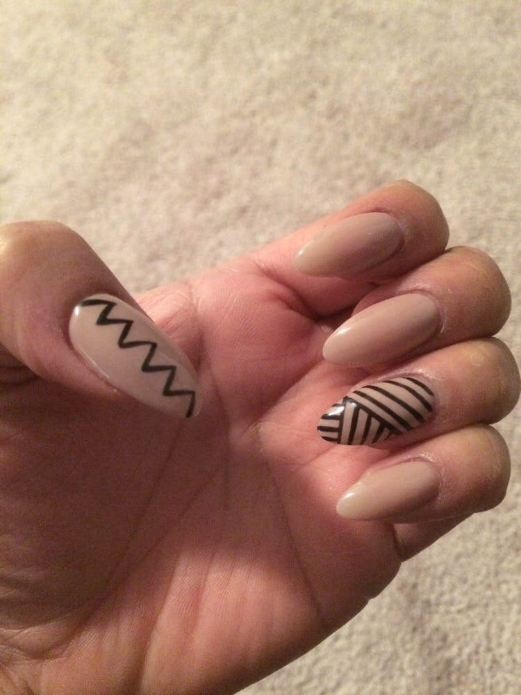Perfect Almond Shaped Nails And Tribal Designs With A Simple Nude