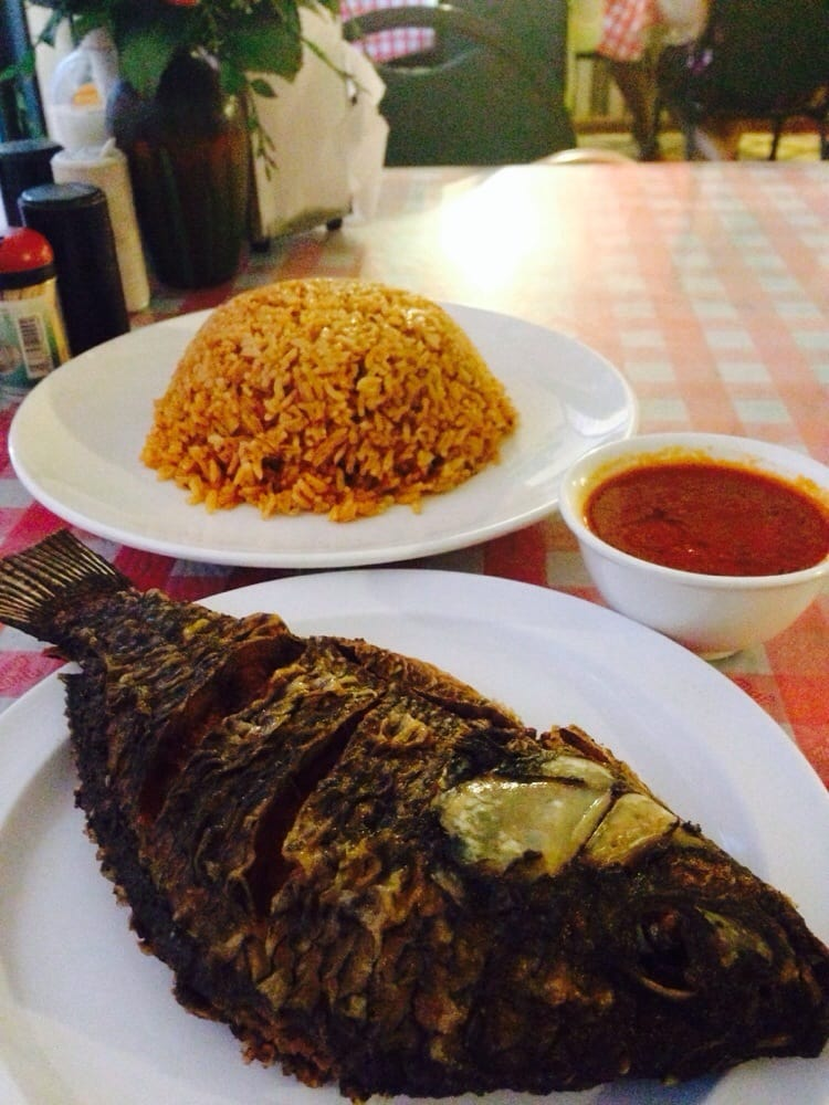 Fried fish with jambalaya style rice and a savory red for Best fried fish near me