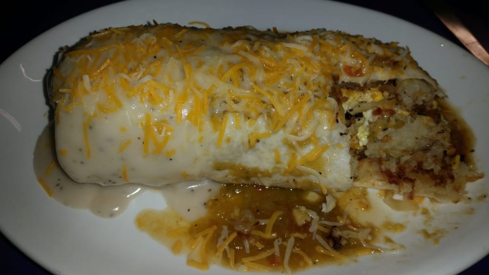 Photo of King's Chef Diner - Colorado Springs, CO, United States. Breakfast Burrito topped with Colorado green chili & country gravy- yuuuum!!