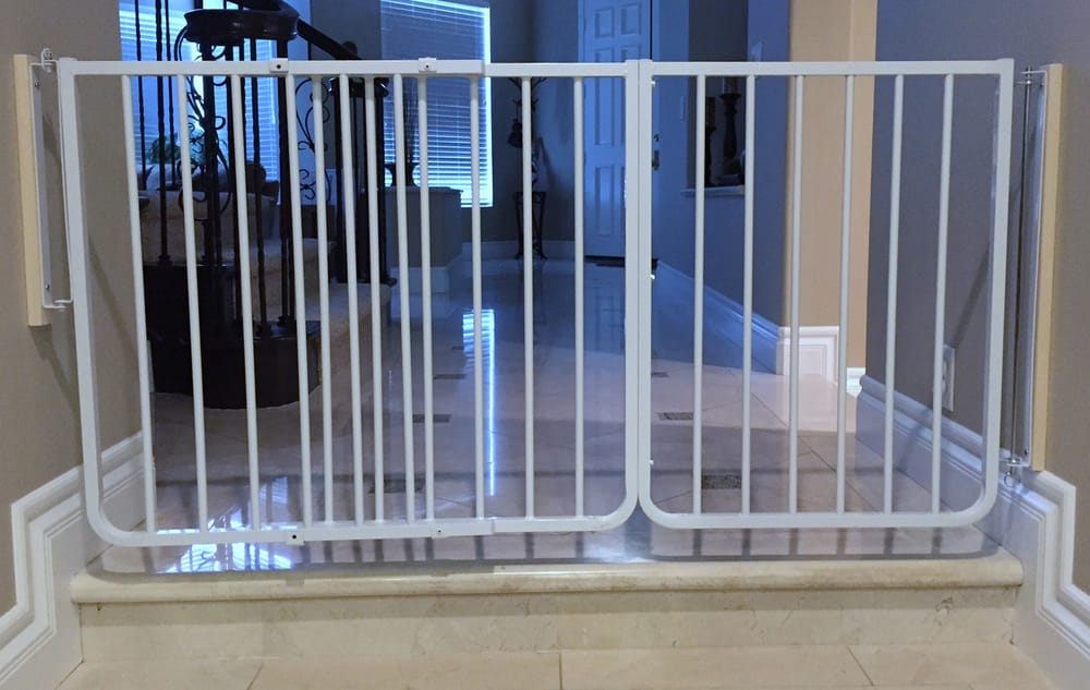 baby gate at bottom of stairs with custom banister kit to mount to spiral stairway spindles yelp