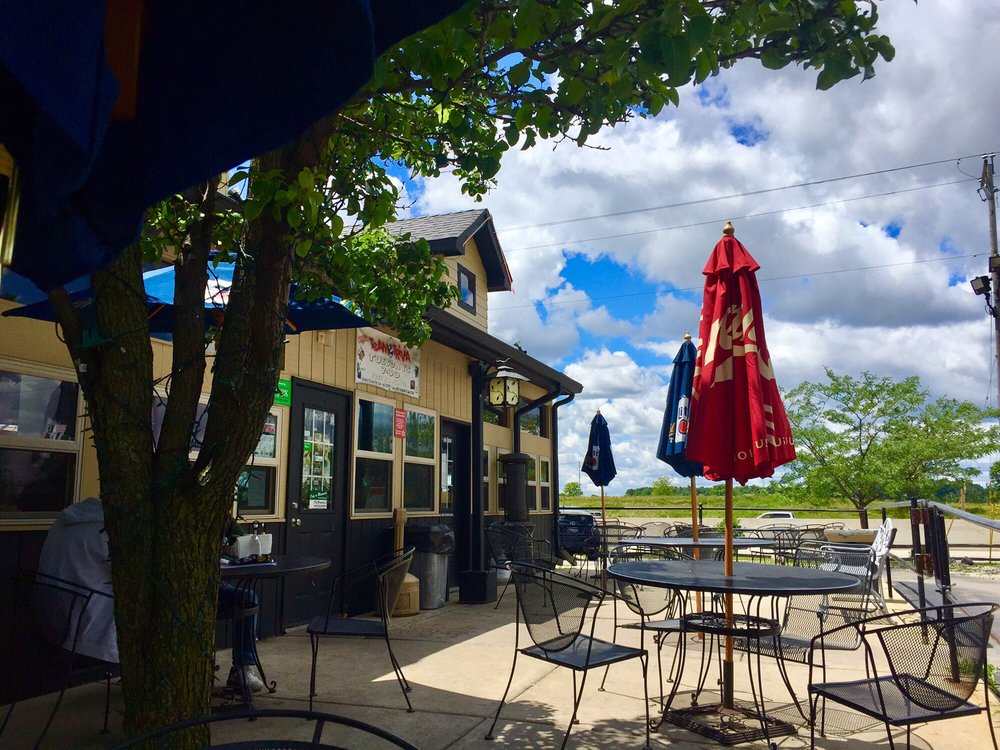 Da patio with its rumblin of highway noise - Yelp