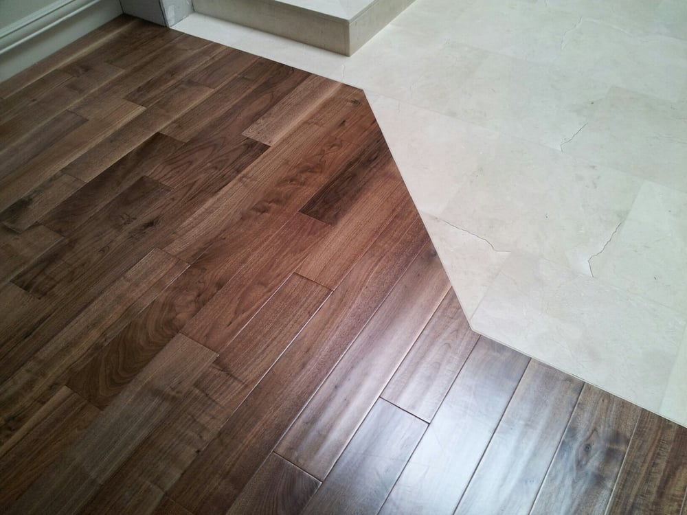 Nail down hardwood against a tile without transition yelp for Wood floor next to tile